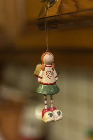 ponytails: Christmas ornaments - toy girl with a heart on her chest and ponytails
