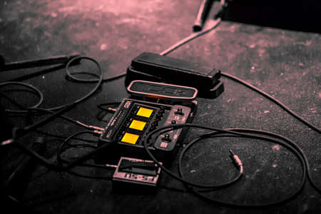 backstage: Electric Guitar audio pedal on the floor and cables