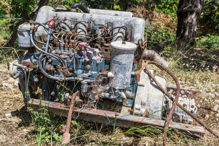 junked: Old car engine in a forest 2