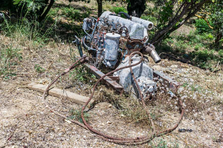 junked: Old car engine in a forest 3