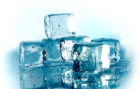 Melting blue ice cubes on white background