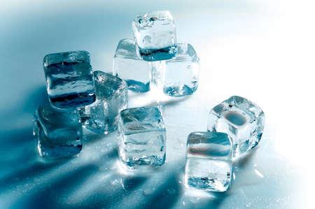 Blue ice cubes on white background