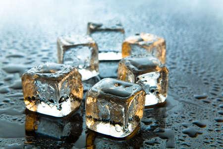 Melting ice cubes on reflective background Stock Photo - 2347992