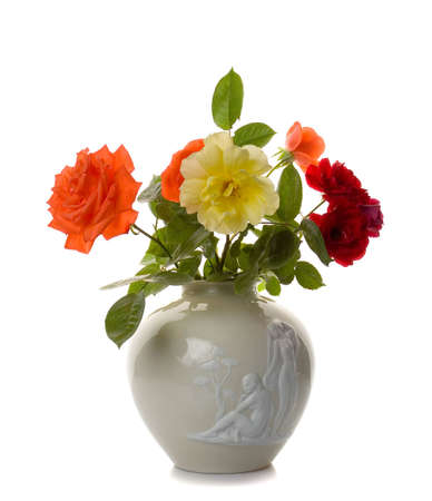 Flowers in vase isolated on white photo