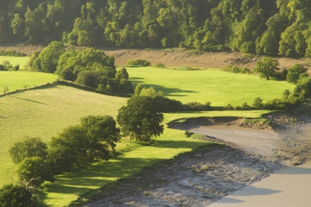 Morning landscape with fields and shadows,  River Wye at the Lancaut Peninsula, Gloucestershire, England, United Kingdom