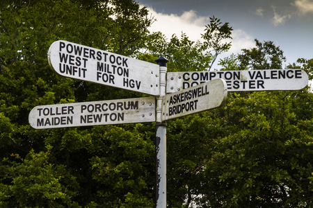 milton: Finger post showing some unusual sounding place names in Dorset, England, United Kingdom. They are:  Powerstock, Weat Milton, Compton Valence, Dorchester, Toller Porcorum, Maiden Newton, Askerswell, Bridport. Also road which is unfit for HGVs.