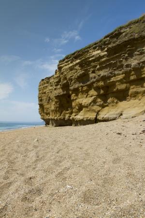 blackman: Sandstone Cliffs with pebbled beach. Hive Beach, Burton Bradstock, Bridport, Dorset, England, United Kingdom.