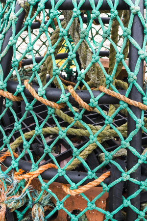 lobster pots: Close up of a UK lobster pot with green twine net