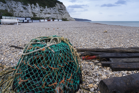 lobster pots: Pebbled beach with Lobster Pot at Beer, Devon, England, United Kingdom