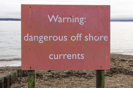 currents: Red notice on UK beach warning of currents at sea. Stock Photo