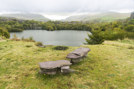 cymru: Looking across the disused Dorothea Slate Quarry, Nantlle, Gwynedd, Wales, United Kingdom. Flooded with water.