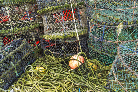 Trawler fishing nets, ropes and equipment set out on Mudeford Quay, Christchurch, Dorset, England, United Kingdom. Stock Photo