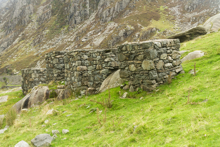 repel: Four anti-tank cubes made from local stone Nant Francon Pass, Ogwen Cottage, Gwynedd, Wales, United Kingdom  Stock Photo