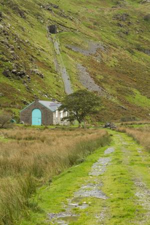 kw: Hydroelectric power station in Cwm Croesor, Gwynedd, North Wales, United Kingdom, behind is incline of the Croesor tramway  Stock Photo