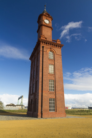 doubled: With three clock faces, this structure doubled as clock tower and watertower providing hydraulic power