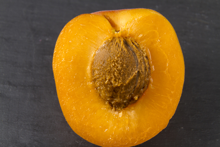 halved  half: Close up of halved Sun Sweet Apricot Stock Photo