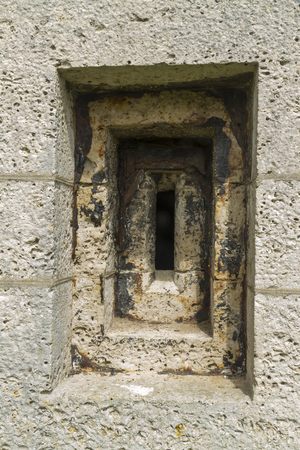 loophole: Artillery loophole in Victorian fort. Nothe fort, Weymouth, Dorset, England, United Kingdom.