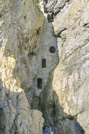 fourteenth: Rumoured to be a smuggler cave, Culver Hole was a dovecote dating back to thirteenth or fourteenth century. Port Eynon, Gower Peninsula, Swansea, South Wales, United Kingdom.