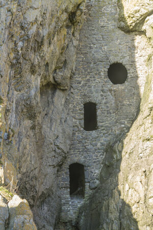 pigeon holes: Rumoured to be a smuggler cave, Culver Hole was a dovecote dating back to thirteenth or fourteenth century. Port Eynon, Gower Peninsula, Swansea, South Wales, United Kingdom.