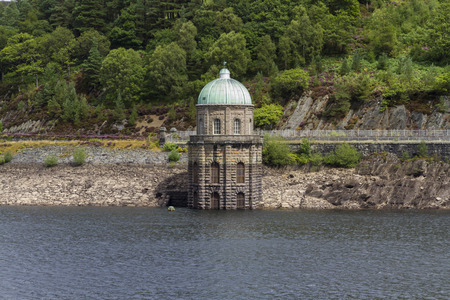 elan: Foel Tower is the intake of the Garreg-ddu Reservoir, water starts its 73 mile journey to Birmingham. Elan Valley, Powys, Wales, United Kingdom, Europe.