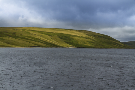 elan: The Claerwen Reservoir, in the mid welsh hills surrounded by hills. Elan Valley, Powys, Wales, United Kingdom, Europe. Stock Photo