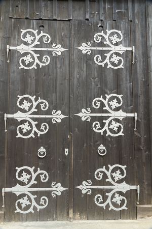 large doors: Large barn doors, with big ornate hinges. Bavarian Alps, Germany, Europe.