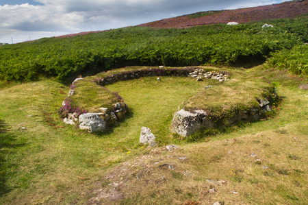 about age: Remains of hut, now a circle. Settlement of about twenty buildings dating 2000BC, Bronze Age. Holyhead, Anglesey, Wales, United Kingdom Stock Photo