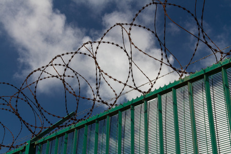 razor wire: Boundary area of ferry terminal. Fence and Razor wire. Dunkirk, France, Europe. Ferries to the UK.