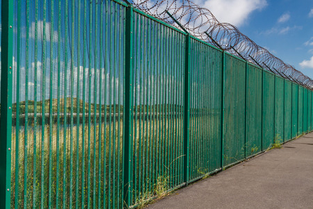 Boundary area of ferry terminal. Fence and Razor wire. Dunkirk, France, Europe. Ferries to the UK.