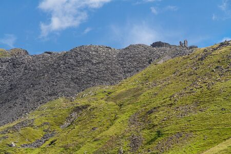 incline: View of Croesor Slate Mine spoil heaps and ruined huge drum house for incline. Snowdonia National Park, Gwynedd, Wales, United Kingdom. Stock Photo