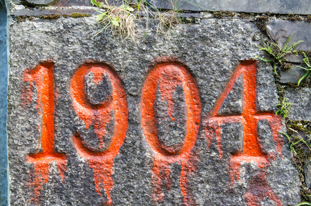 4 5 year old: Year Nineteen hundred and four engraved and painted over with red paint, year stone.