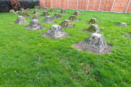 pyramidal: Pyramidal concrete formations, anti-tank obstacles from WWII. Rye, Kent, England, United Kingdom.