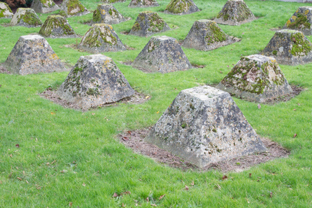 Pyramidal concrete formations, anti-tank obstacles from WWII. Rye, Kent, England, United Kingdom. photo