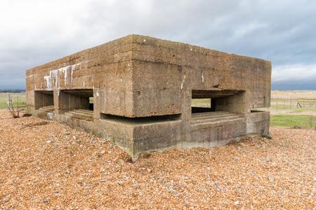 vickers: Concrete WWII Vickers Machine Gun Post. Rye Harbour, Kent, England, United Kingdom. Stock Photo