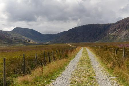 wen: Track into Cwm Eigiau with Carnedd Mountains in the distance. Conwy Snowdonia National park Gwynedd Wales United Kingdom