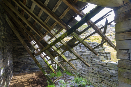 collapsing: Derelict stone building collapsing roof Snowdonia Wales United Kingdom