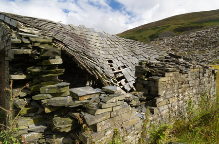 Derelict stone building collapsing roof Snowdonia Wales United Kingdom