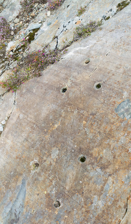 cymru: Rock Cannon were holes drilled in rock used in celebrations when gunpowder exploded. This associated with Dinorwic Slate Quarry Snowdonia Wales United Kingdom