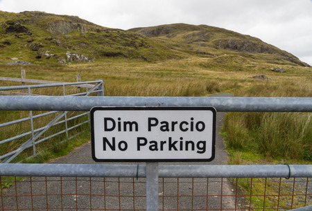 bilingual: Farm gate with sign Dim Parcio No Parking bilingual in Welsh and English. Wales United Kingdom. Stock Photo