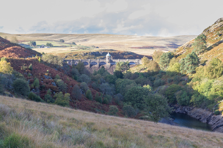 elan: Looking across valley to the Craig Goch dam and reservoir. Autumn fall  tree colours.