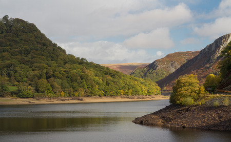 elan: The Garregddu Reservoir in the mid welsh hills surrounded by hills. Elan Valley Powys Wales United Kingdom Europe Stock Photo