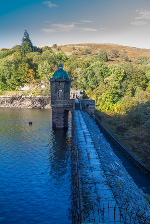 elan: Blue evening light over the top pf PenyGarrog Dam and Reservoir. Elan Valley Powys Wales United Kingdom Europe.
