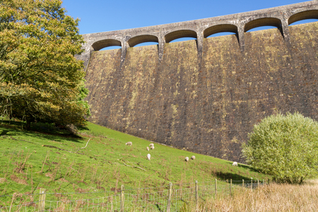 elan: The Claerwen Reservoir and Dam part of the Elan Valley Reservoirs. Powys Wales United Kingdom. Stock Photo
