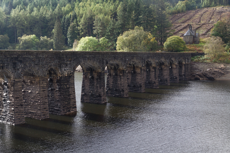 elan: Arches of Submerged Dam with road on top. Garregddu Reservoir Elan Valley Powys Wales United Kingdom Europe.