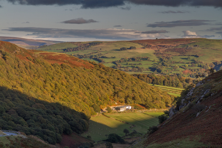 elan: Looking down from Hill at valley farm, last few minutes of sunlight, evening, autumn, fall. Near Elan Valley, Powys, Wales, United Kingdom, Europe.