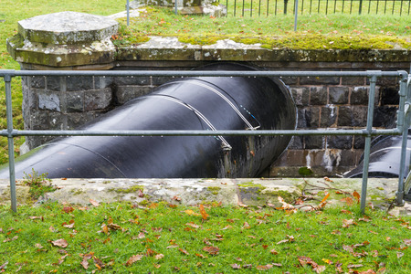 elan: Elan Aqueduct  73 mile pipeline taking water from the Elan Valley reservoirs, Wales, over the River Severn to Birmingham.  Black pipe. Stock Photo