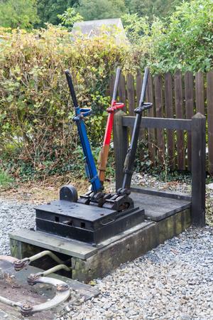 Outside exterior three railway signal semaphore levers. Vale of Rheidol Railway, Ceredigion, Wales, United Kingdom, Europe. Imagens - 43201391