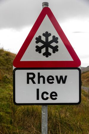 bilingual: Snowflake triangular warning sign, Wales, warning of Ice, Welsh bilingual Rhew, United Kingdom