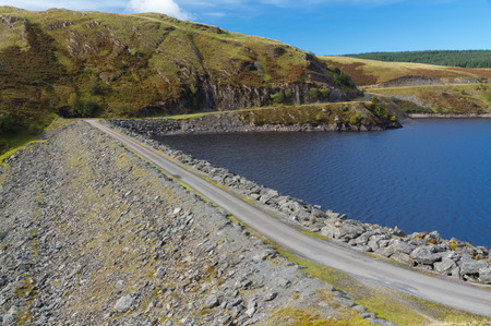 Head, dam and start of the spillway of the Llyne Brianne reservoir, which dams the Rover Towy. Llanwrtyd Wells, Powys, Wales, United Kingdom, Europe