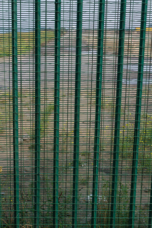 deterrent: Boundary area of ferry terminal. Fence to deter refugees, asylum seekers. Dunkirk, France, Europe. Ferries to the UK. Migrants are trying to get to the United Kingdom from French ports Stock Photo